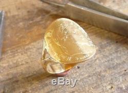 Bague pièce or cintrée demi jonc avec 10 Francs or Napoléon tête laurée