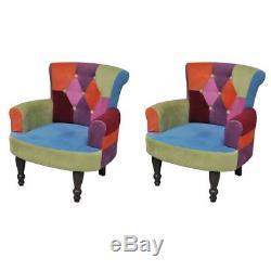 Un ou deux fauteuils de style France avec accoudoirs design patchwork élégant